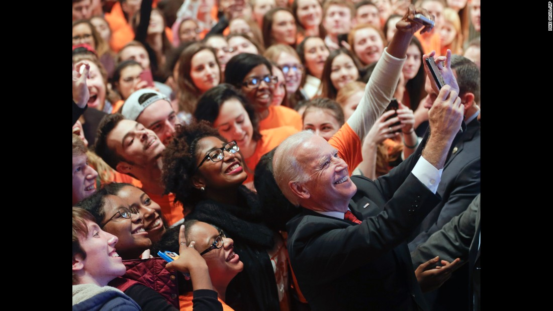 U.S. Vice President Joe Biden poses with students at Syracuse University after he spoke at the school Thursday, November 12, in Syracuse, New York.