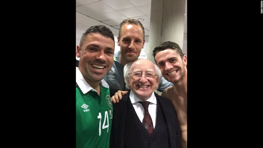 "Irish soccer player Jon Walters, left, takes a selfie with teammates and Ireland President Michael D. Higgins after he scored two goals to help his country clinch a spot in next year's European Championships. ""Not one for selfies after games but you can't miss one with the president,"" <a href=""https://twitter.com/JonWalters19/status/666381963830435841"" target=""_blank"">Walters tweeted.</a> ""Have a bit of that!"" <a href=""http://www.cnn.com/2015/11/11/living/gallery/look-at-me-selfies-1111/index.html"" target=""_blank"">See 25 selfies from last week</a>"
