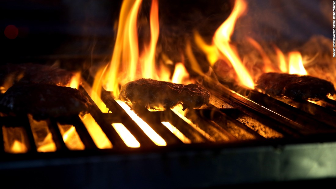The uncontrollable heat and flames of a barbecue sometimes lead to uncooked burgers; always make sure they are well-done to avoid an upset stomach.
