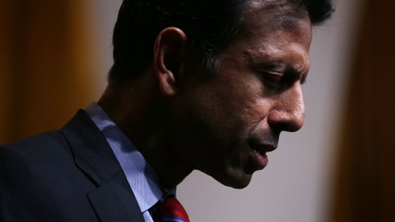 """Louisiana Governor Bobby Jindal leads a prayer for victims of the Charleston shooting during the """"Road to Majority"""" conference June 19, 2015 in Washington, D.C."""