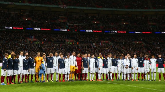 England and France players pose for a moment of applause prior to the international friendly match at Wembley Stadium on November 17, 2015.