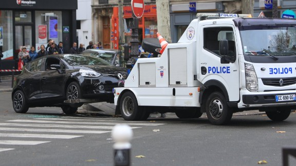 A Renault Clio with Belgian license plates is towed by the police in Paris on Tuesday, November 17. The car is believed to have been rented by Salah Abdeslam. Authorities are looking for Abdeslam, a Belgium-born French national who is one of three brothers suspected in the terror attacks.