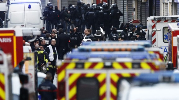 Police gather during the raid in Saint-Denis.
