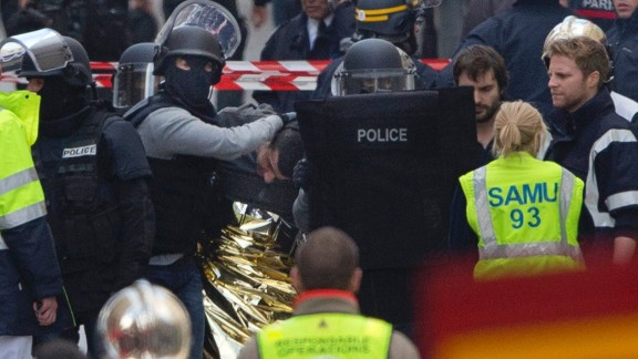 Police officers detain a man in Saint-Denis on November 18.