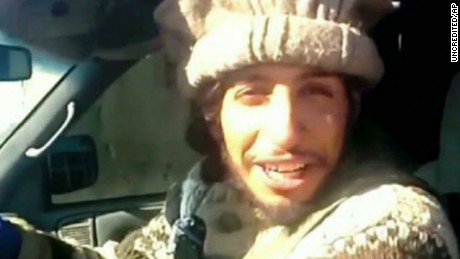 This undated image taken from a Militant Website on Monday, Nov.16, 2015, shows Belgian Abdelhamid Abaaoud. A senior police official said on Wednesday, Nov. 18, 2015, that he believed the Belgian Islamic State militant was inside an apartment in the Paris suburb of Saint-Denis with other heavily armed people. A French official said Monday that Abdelhamid Abaaoud is the suspected mastermind of the Paris attacks was also linked to thwarted train and church attacks. (Militant video via AP)