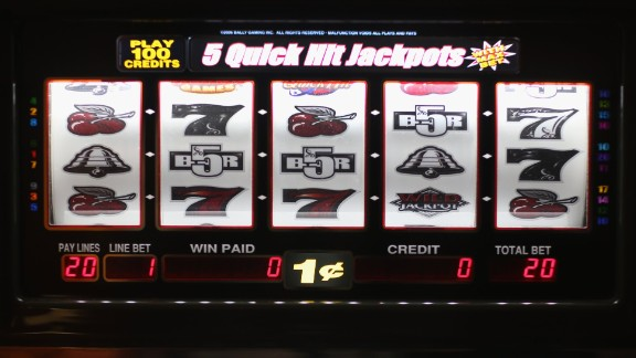 """HIALEAH, FL - AUGUST 28:  A slot machine is seen in the casino that will hold its grand opening on Friday located in the Hialeah Park Race Track which first opened in 1925 on August 28, 2013 in Hialeah, Florida. The new casino is located in the same complex as the race track which in its heyday was known as the """"the worlds most beautiful race course.""""  (Photo by Joe Raedle/Getty Images)"""