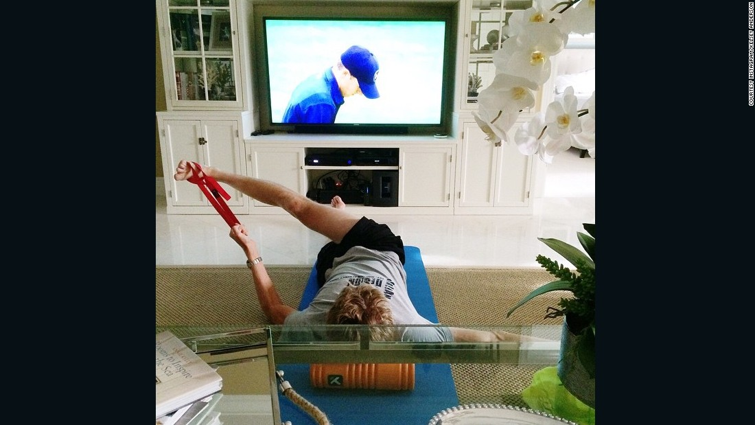 At home in Miami, Kevin works out while matching the Masters golf tournament on TV, in this snap also from Kelsey's Instagram account.