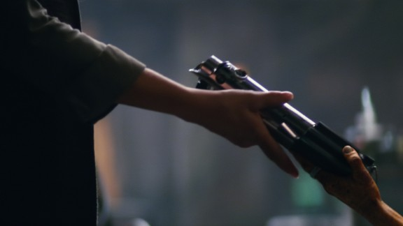 "This shot from the official trailer shows a lightsaber changing hands, while Luke Skywalker, talking about the Force, says, ""My sister has it."" The lightsaber in question looks like Anakin"