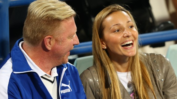 Jelena Djokovic (right) speaks with Boris Becker.