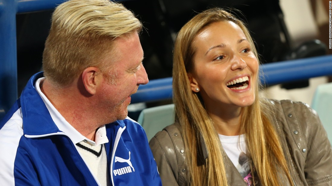 Novak Djokovic's wife Jelena shares a joke with his coach Boris Becker. The world No. 1 married his longtime partner last year and they have since had their first child. <br />
