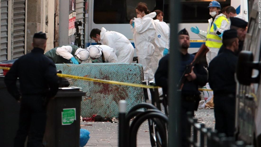 Video shows Paris terrorist aim at woman, gun doesn't fire - CNN