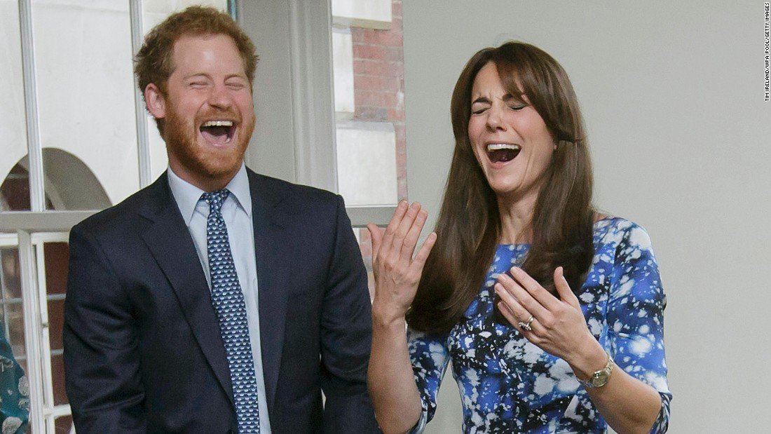 "Britain's Prince Harry and his sister-in-law, Catherine, Duchess of Cambridge, laugh as they take part in a ""welly wanging"" charity event in London on Monday, October 26. Welly wanging involves throwing a Wellington boot as far as possible."