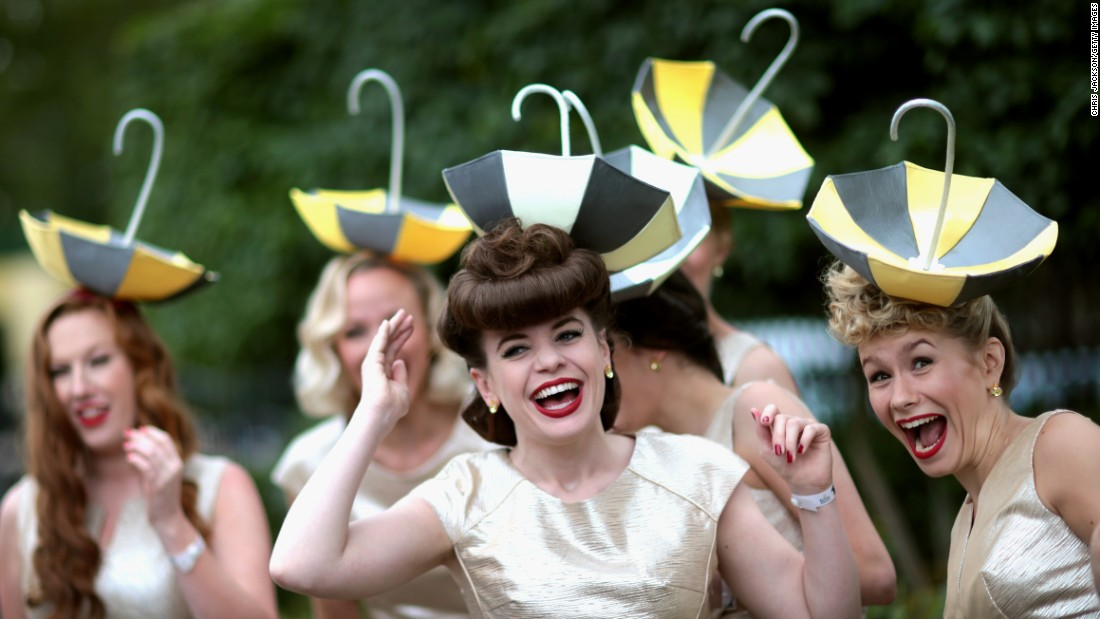 The Tootsie Rollers, an all-girl band from London, attend the Royal Ascot horse races in Ascot, England, on Wednesday, June 17.