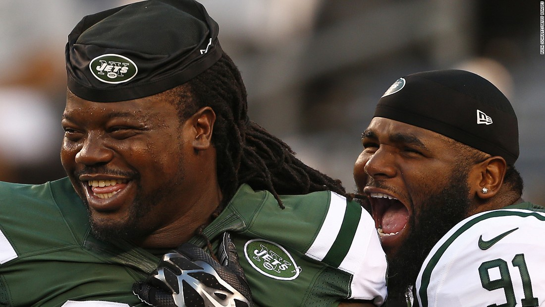 Two New York Jets -- Damon Harrison, left, and Sheldon Richardson -- laugh before an NFL preseason game in East Rutherford, New Jersey, on Thursday, September 3.