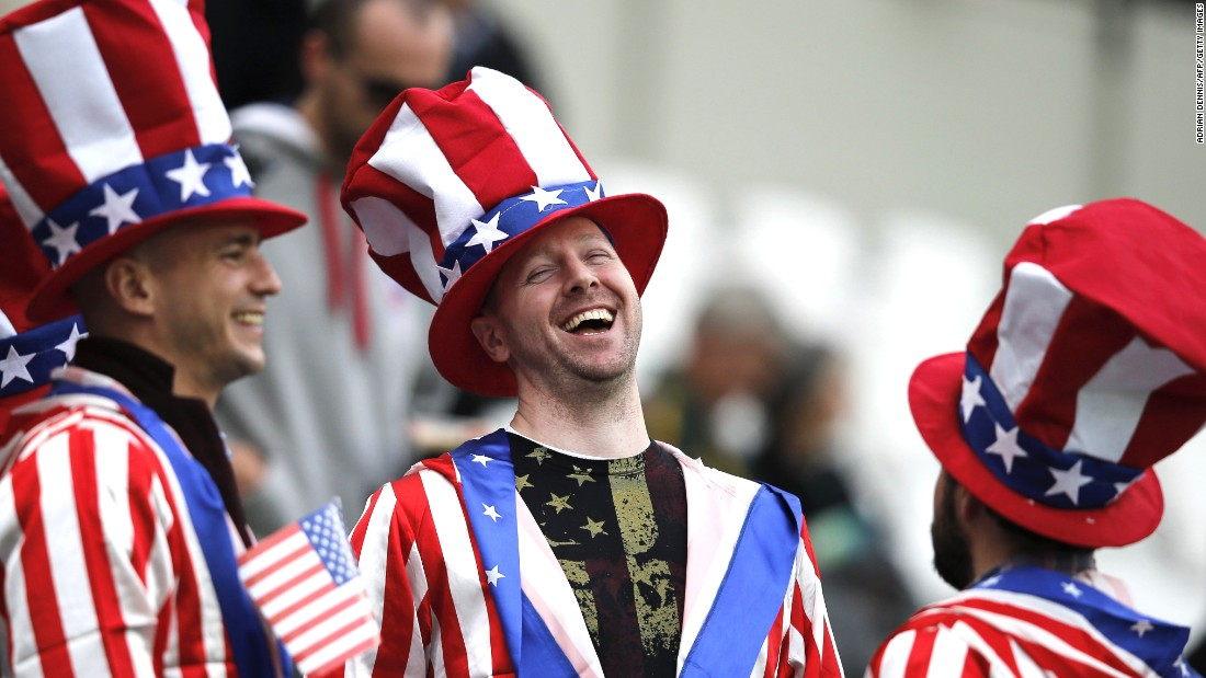 Rugby fans laugh together prior to a Rugby World Cup match between the United States and South Africa on Wednesday, October 7.