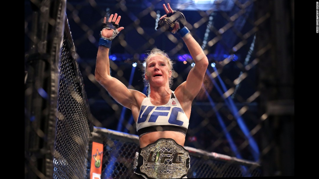 Holly Holm celebrates her stunning upset over Ronda Rousey after their UFC bantamweight championship bout Sunday, November 15, in Melbourne, Australia. Here's a look at Holm's life and career.