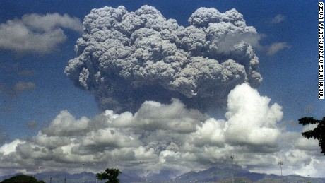 A giant mushroom cloud of steam and ash exploding out of Mount Pinatubo volcano during its eruption in 1991.