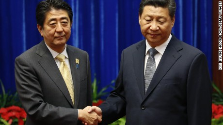 BEIJING, CHINA - NOVEMBER 10: Japan's Prime Minister Shinzo Abe shakes hands with China's President Xi Jinping (R), during their meeting at the Great Hall of the People, on the sidelines of the Asia Pacific Economic Cooperation (APEC) meetings, November 10, 2014 in Beijing, China. APEC Economic Leaders' Meetings and APEC summit is being held at Beijing's outskirt Yanqi Lake. (Photo by Kim Kyung-Hoon-Pool/Getty Images)
