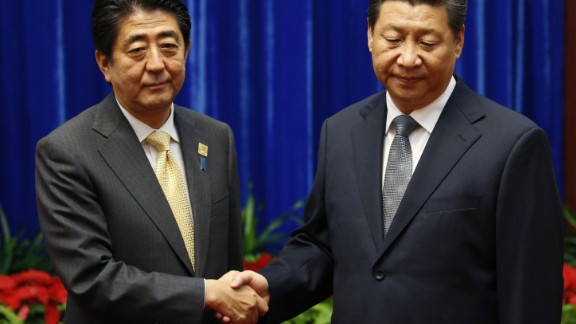 Japanese Prime Minister Shinzo Abe meets with Chinese President Xi Jinping at a 2014 forum.