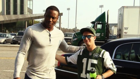 Brandon Marshall, wide receiver for the New York Jets, poses for a picture with Daniel Lewis, an Omaze contest winner.