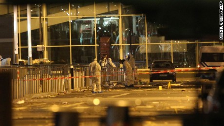 Police work outside the Stade de France after the explosions.
