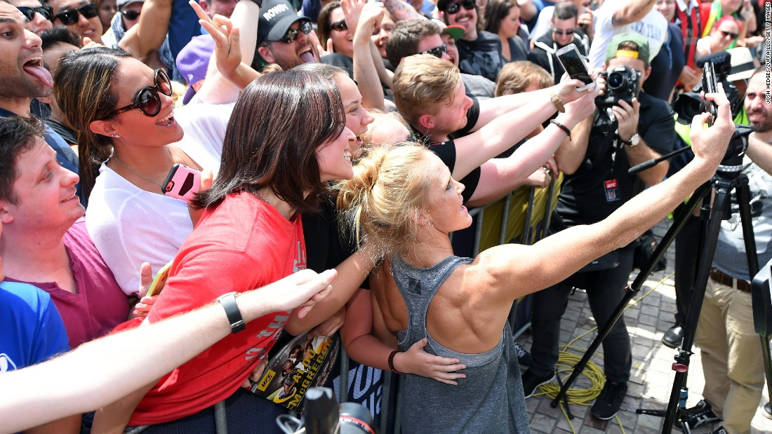 Holm takes a selfie with fans after an open prefight workout November 12 at Federation Square in Melbourne. In the past week, the little-known fighter has gained 1.4 million social media followers.