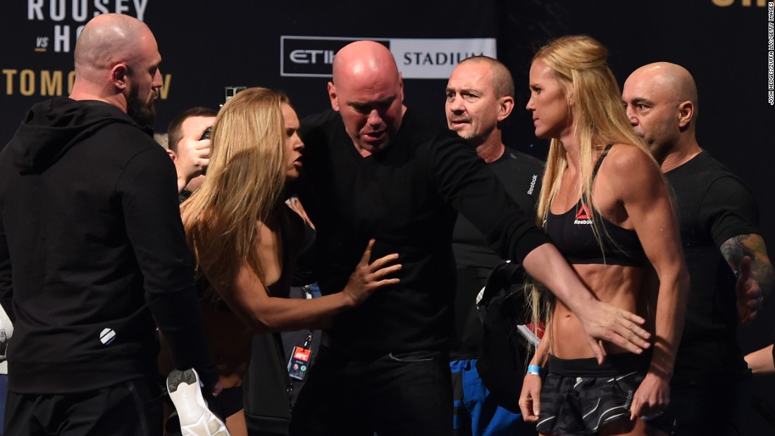 Rousey, left, and Holm face off during the weigh-in the day before their fight. Things got a little testy during their staredown, so UFC President Dana White, center, stepped in and defused the situation.