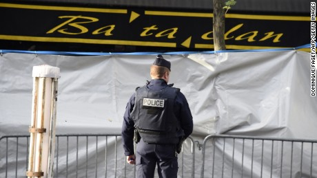 A police officer stands guard outside the concert hall days after the attacks.