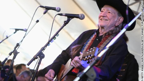 WEST HOLLYWOOD, CA - APRIL 13:  Musican Willie Nelson performs at the John Varvatos 11th Annual Stuart House Benefit presented by Chrysler, Kids Tent by by Hasbro at John Varvatos Boutique on April 13, 2014 in West Hollywood, California.  (Photo by Rachel Murray/Getty Images for John Varvatos)