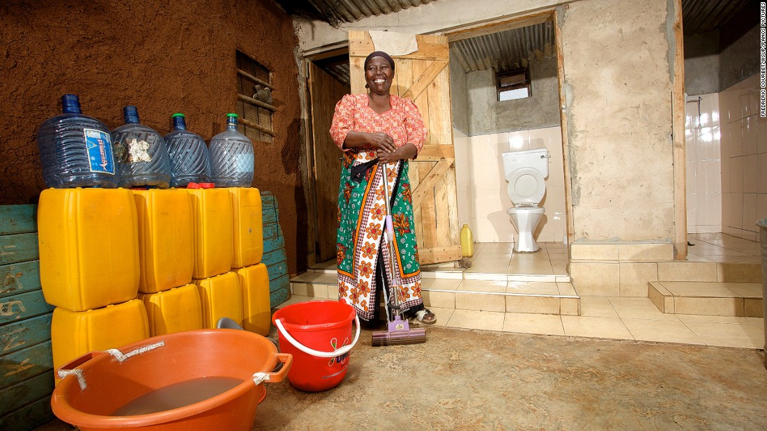 "Maka, 50, lives in Kibera in Nairobi. Her toilet is a stone walled pour-flush toilet, which is connected to the sewer.She says: ""My toilet was very expensive to construct, but my son who works in Saudi Arabia helped me to pay for it. It is much better for my mother, who is very elderly and cannot walk to the public toilets, which are outside our compound. I am very happy because I have a beautiful clean toilet."""