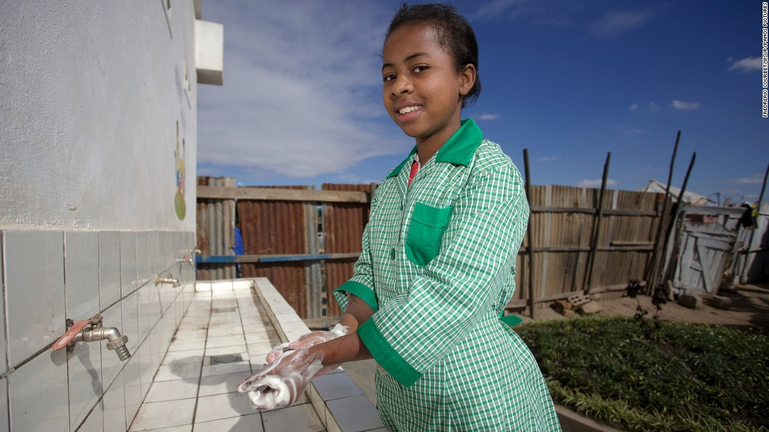 "Erika, 14, uses the new toilets at her school in Antananarivo.She says: ""With these new toilets, I don't have to walk through dirty toilets with urine all over the floor. At home my younger brothers are constantly exposed to the risk of infections, which cause them to have diarrhoea and miss school"""