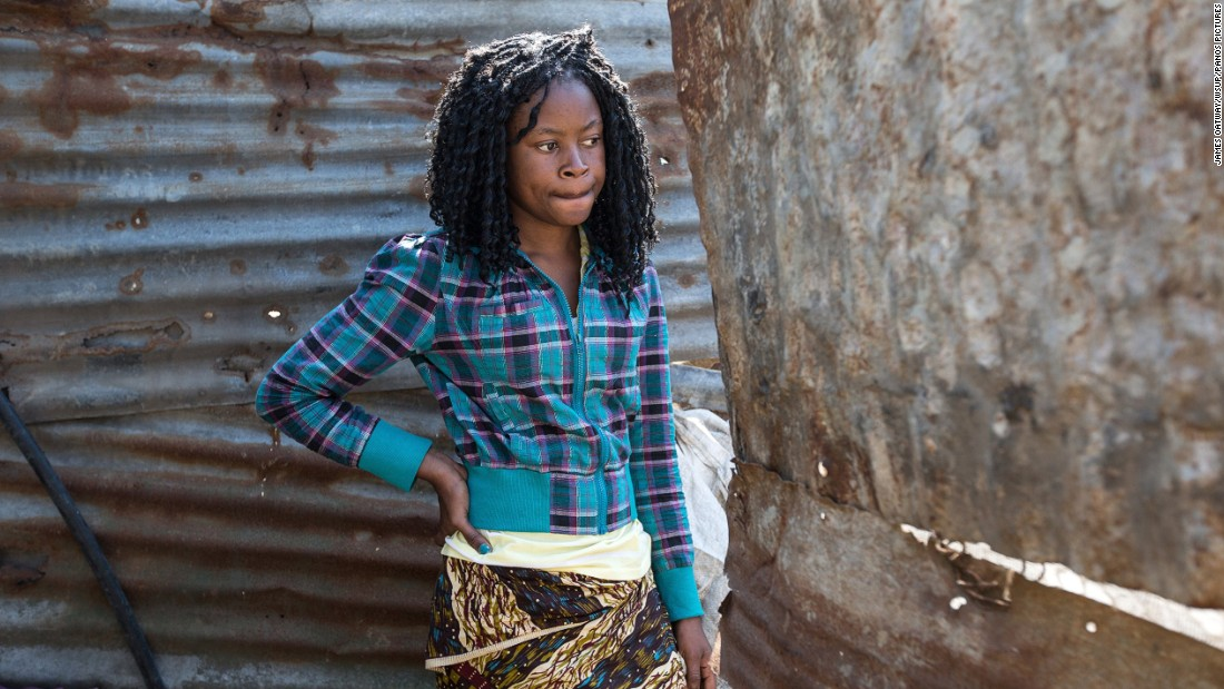 "Flora, 19, is a high school student. She lives in Chamanculo C in Maputo with her mother, sister and niece. She shares a toilet with several other families living nearby.She says: ""I hate using this toilet. Sometimes men peek over the fence. There is no privacy."""