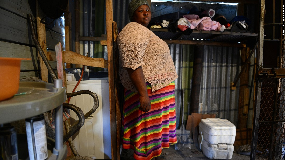"Nombini has two Porta Potties, which are used by the 12 people who live in her home. When she first moved to Khayelitsha in 2005, she did not have a toilet so she had to go in the bush, across a main road.""It was terrible in the bush, the cars hit you. When we were given a Porta Potty in 2009, it was much better than going in the bush. Flush toilets are first class compared to the Porta Potty though. My dream is to have a flush toilet."""