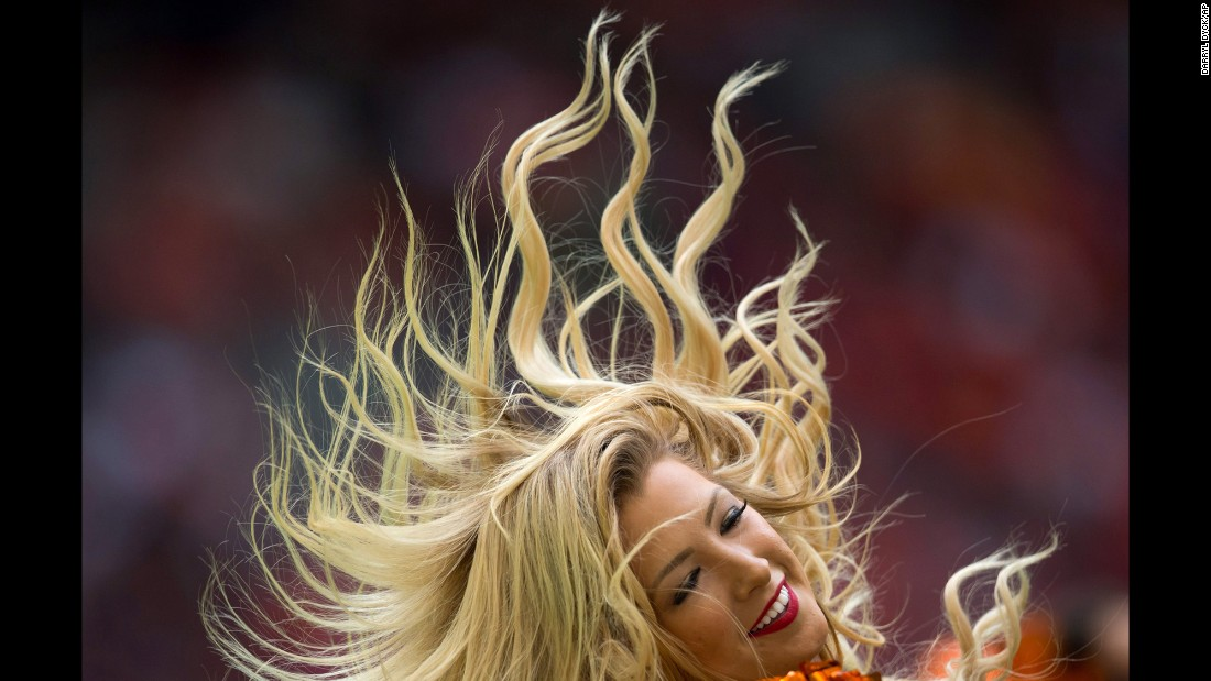 A cheerleader for the BC Lions performs during a Canadian Football League game in Vancouver, British Columbia, on Sunday, September 13.