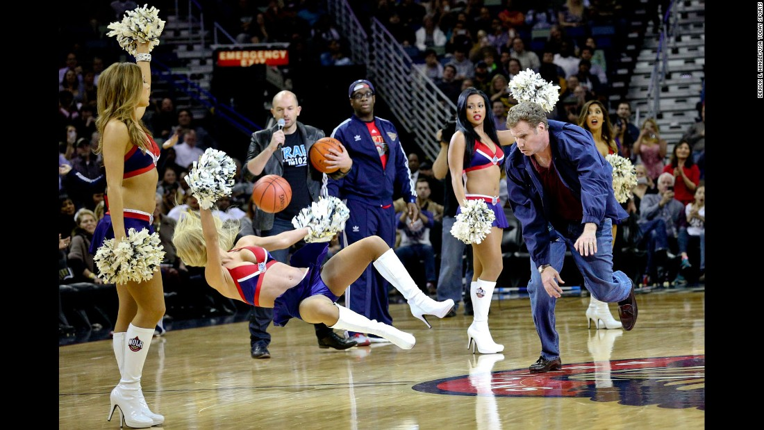 "Actor Will Ferrell hits an actress with a basketball while filming a scene for a movie, ""Daddy's Home,"" on Wednesday, January 21. The scene was shot during halftime of a New Orleans Pelicans game."