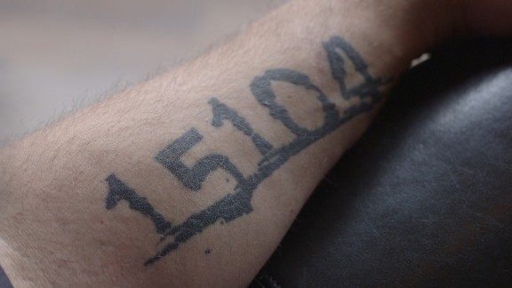 Fetterman has Braddock's zip code tattooed on his arm.