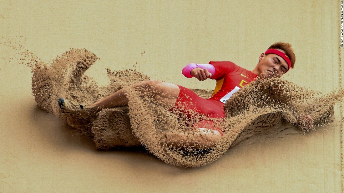 Chinese long jumper Jinzhe Li lands in the sand while qualifying at the World Championships in Beijing on Monday, August 24.