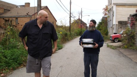 Fetterman delivers food to one of his neighbors.