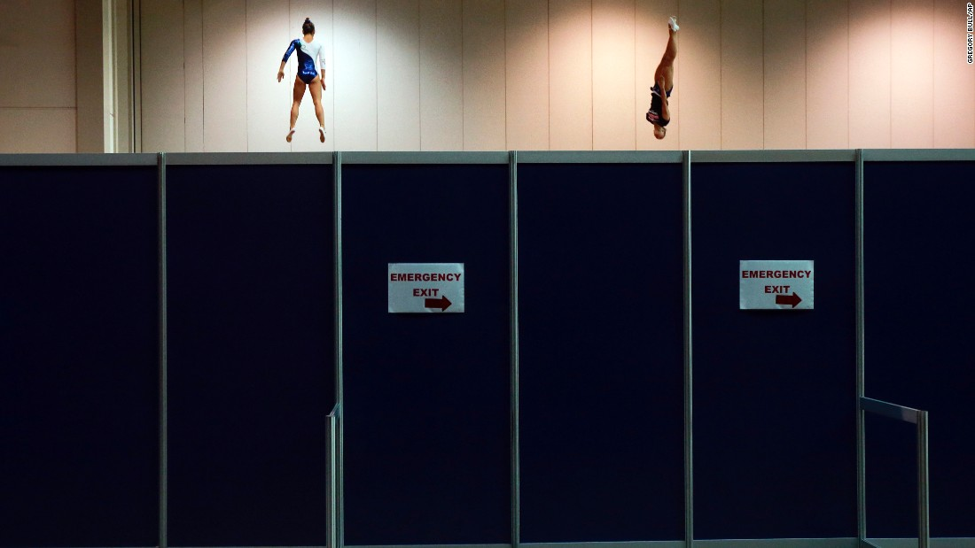 Brazilian Camilla Lopes, left, and American Charlotte Drury warm up before competing in the trampoline event at the Pan American Games in Toronto on Sunday, July 19.