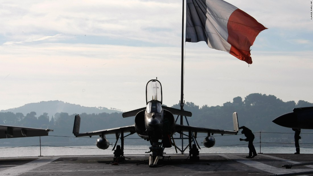 A sailor checks a fighter jet on the deck of France's Charles de Gaulle aircraft carrier on Wednesday, November 18. The massive ship was deployed to the eastern Mediterranean Sea to join the fight against the ISIS militant group that claimed responsibility for the Paris terror attacks.
