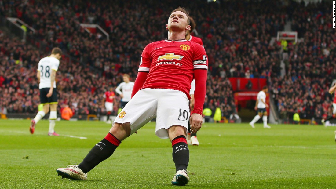 Manchester United captain Wayne Rooney falls backward as he celebrates a  goal Sunday ad0caf177