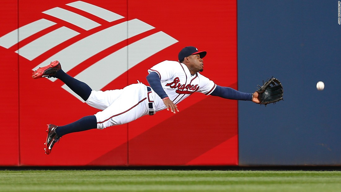 Atlanta center fielder Eric Young Jr. dives for a ball during a home game against Washington on Monday, April 27.