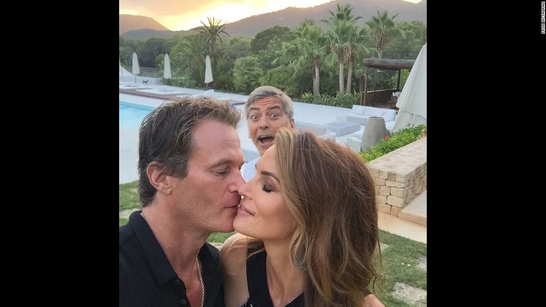 "George Clooney photobombs model Cindy Crawford during an intimate moment with her husband, Rande Gerber,<a href=""https://instagram.com/p/6vG8KuTLaX/"" target=""_blank""> in this selfie</a> posted Sunday, August 23."