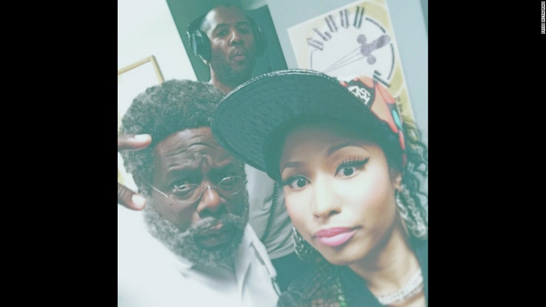 "Singer Nicki Minaj <a href=""https://instagram.com/p/4GbOxJr8bE/?taken-by=nickiminaj"" target=""_blank"">snaps a picture</a> on the set of the film ""Barbershop 3"" on Friday, June 19. At left is Cedric the Entertainer, who Minaj called the ""funniest dude on the planet,"" and behind them is director Malcolm D. Lee. ""Always happy when these two are around,"" she said on Instagram."