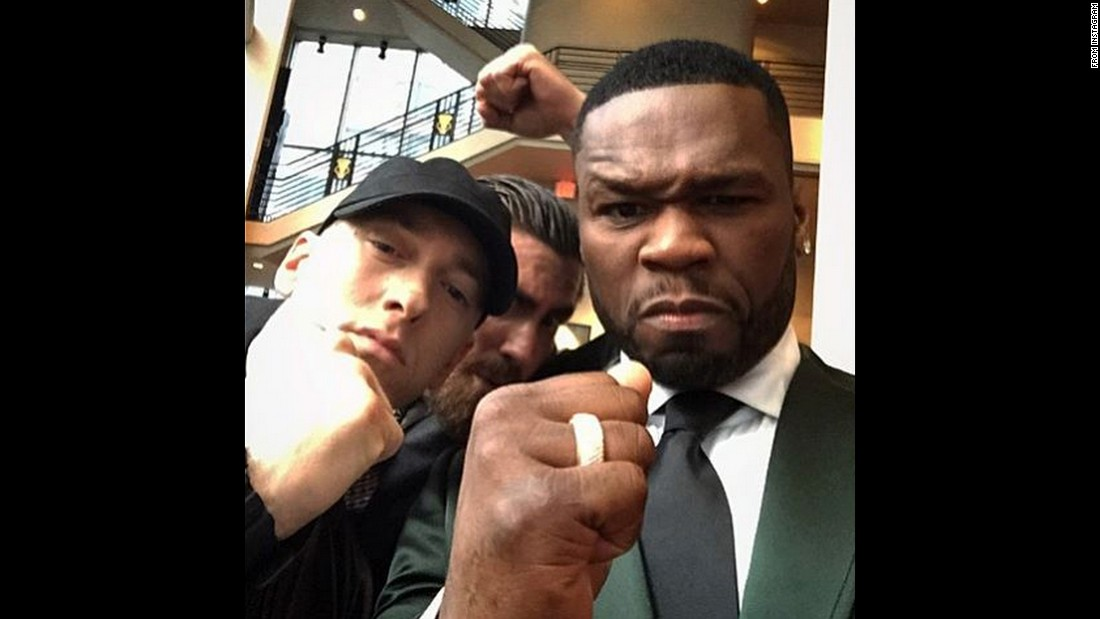 "That's actor Jake Gyllenhaal behind rappers Eminem and 50 Cent in this photo that 50 Cent <a href=""https://instagram.com/p/5YQv4zsL_Q/"" target=""_blank"">posted to Instagram</a> on Monday, July 20. They were putting their fists up to promote ""Southpaw,"" a boxing movie starring Gyllenhaal and 50."