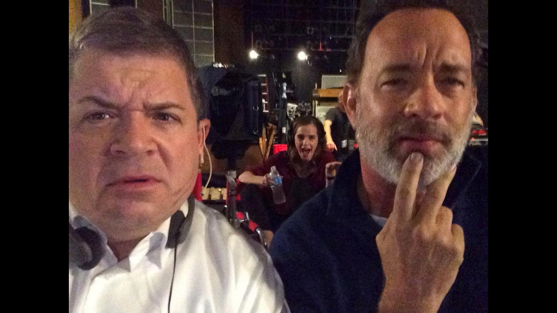 """Watching the #GOPDebate on set and we're all very confused,"" <a href=""https://twitter.com/pattonoswalt"" target=""_blank"">tweeted comedian Patton Oswalt,</a> left, with actor Tom Hanks on Wednesday, September 16. Hanks and Oswalt -- and Emma Watson, in the background -- were filming the movie ""The Circle."""