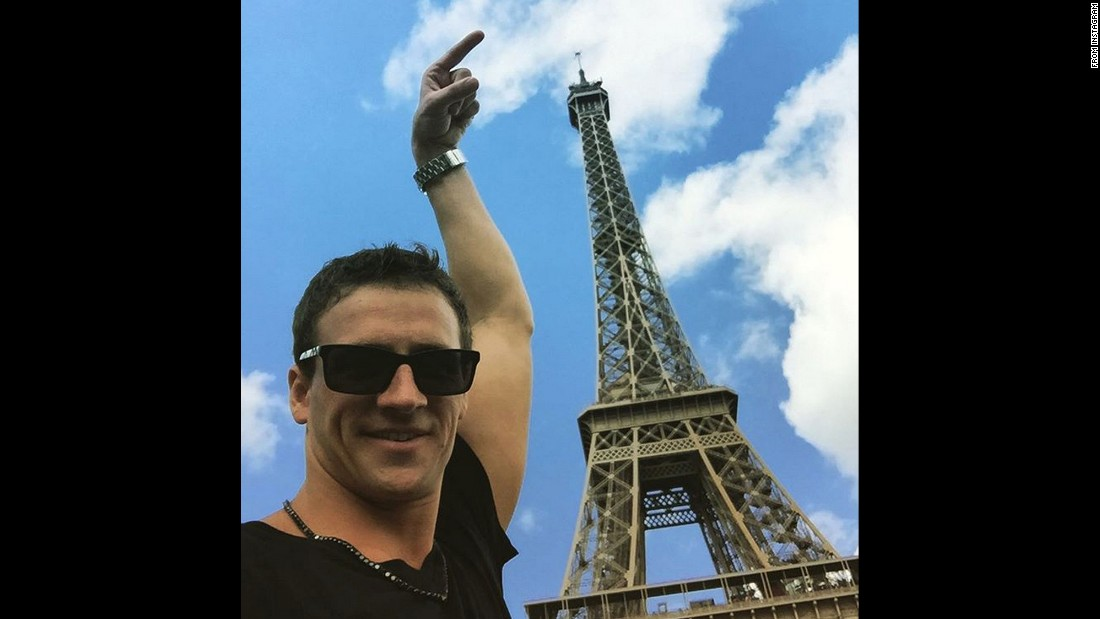 "Swimmer Ryan Lochte sizes up the Eiffel Tower in Paris on Friday, August 14. ""Nailed it!!"" <a href=""https://instagram.com/p/6XGcgpBGk5/"" target=""_blank"">he said on his Instagram post.</a>"