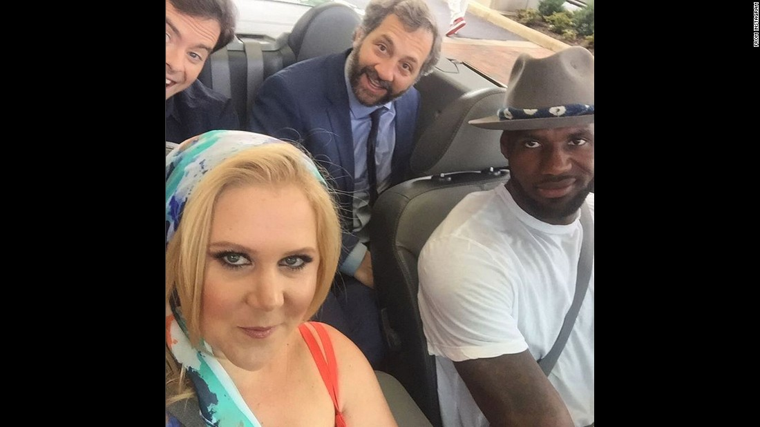 "Comedian Amy Schumer rides shotgun with basketball star LeBron James on Friday, July 10. Behind them, from left, are ""Trainwreck"" co-star Bill Hader and the film's director, Judd Apatow. ""Just a ride,"" <a href=""https://instagram.com/p/4-j-J4KUND/"" target=""_blank"">Schumer said on Instagram.</a> They were shooting a skit for ""Funny or Die."""