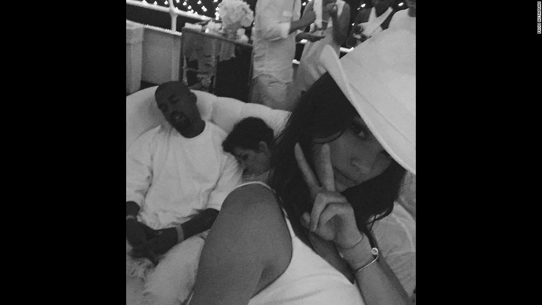 "Model Kendall Jenner <a href=""https://instagram.com/p/678W6ojo88/"" target=""_blank"">takes a selfie</a> of her brother-in-law, rapper Kanye West, snoozing next to her mother, Kris, on Friday, August 28."