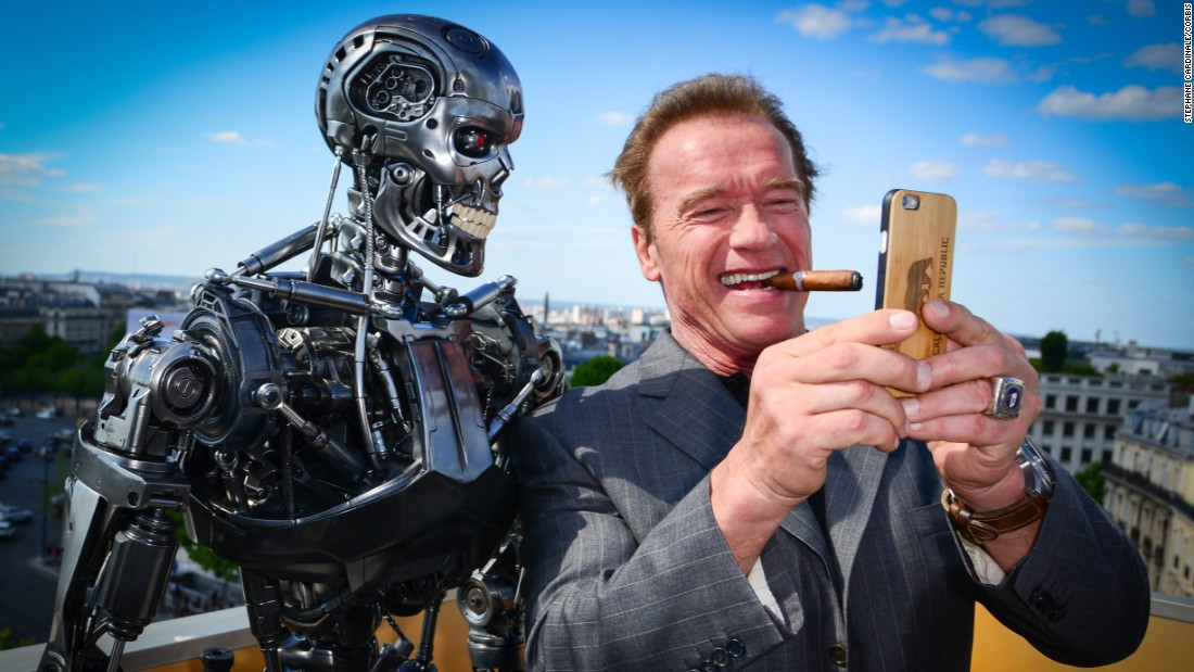 "Actor Arnold Schwarzenegger takes a selfie with a ""Terminator"" robot while he was in Paris promoting the franchise's latest movie on Friday, June 19. <a href=""http://www.cnn.com/2015/06/25/living/gallery/tbt-arnold-schwarzenegger/index.html"" target=""_blank"">#tbt: See Schwarzenegger before he was the ""Terminator""</a>"